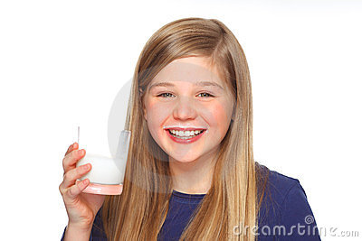 Teenage girl with milk and mustache