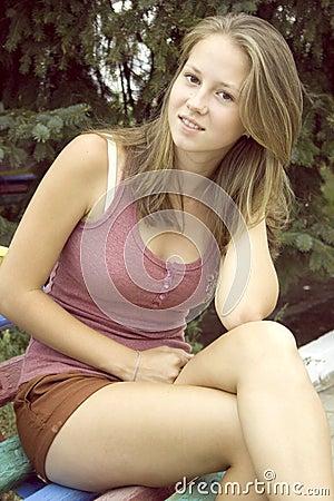 Teenage girl on natural background