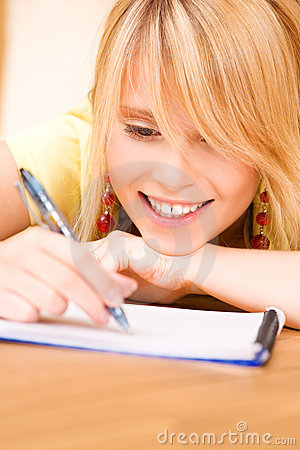 Teenage girl with notebook and pen