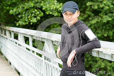 Teenage girl outdoor in sport outfit jogging
