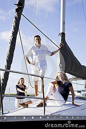 Teenage girl and parents on sailboat at dock
