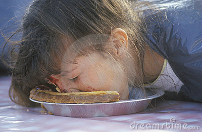 Teenage girl in a pie-eating contest, Editorial Photography