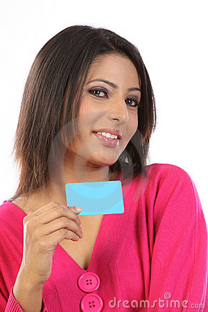 Teenage girl in pink dress with credit card