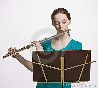 Teenage girl playing flute