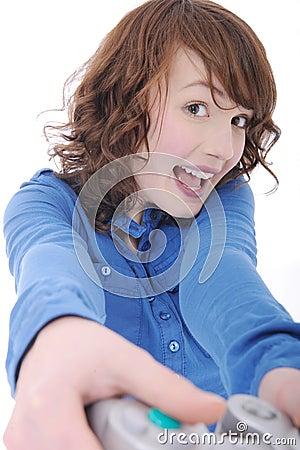 Teenage girl playing videogame