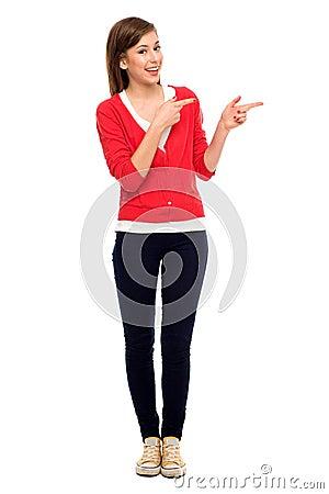 Teenage girl pointing