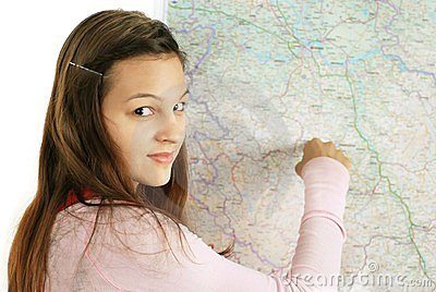 Teenage girl pointing at map