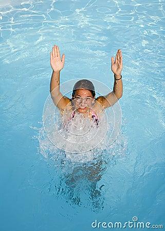 Teenage girl in a pool