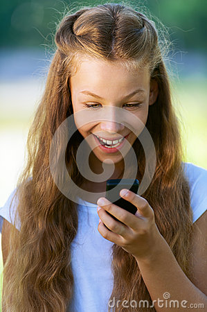 Teenage girl reading funny message