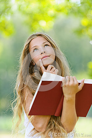 Teenage girl reading red book
