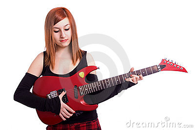 Teenage girl with a red guitar