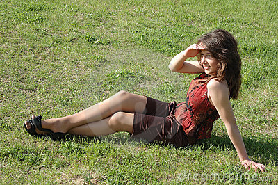 Teenage girl relaxing on grass