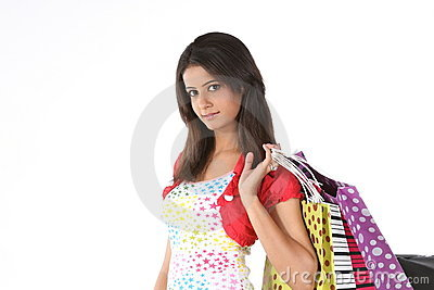 Teenage girl returning with shopping bags