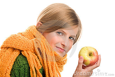 Teenage girl with ripe apple
