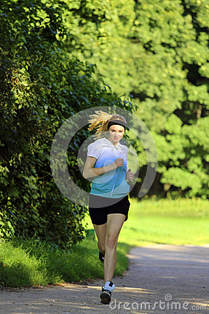Girl running on path