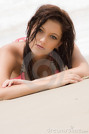 Teenage girl on sand at beach