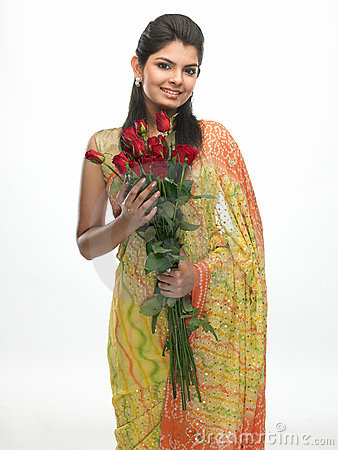 Teenage girl in sari holding red roses