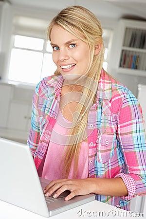 Teenage girl sat using laptop