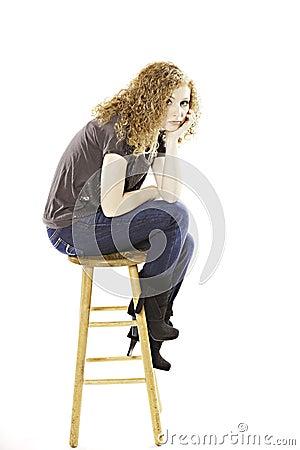 Teenage Girl Seated on Stool