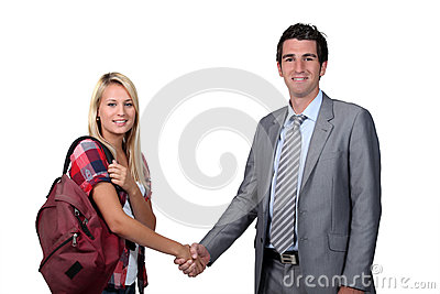 Teenage girl shaking teacher s hand