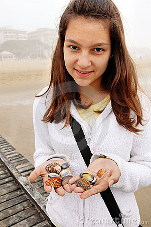 Teenage girl with shells