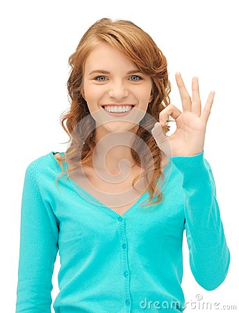 Teenage girl showing ok sign