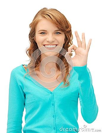 Teenage girl showing ok sign