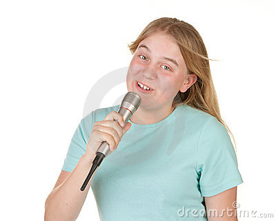 Teenage girl singing karaoke