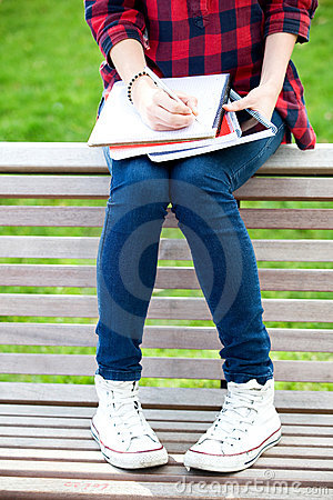 Teenage girl sitting on a bench