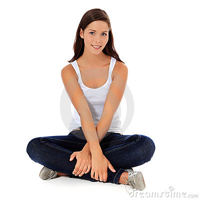 Teenage girl sitting on the floor