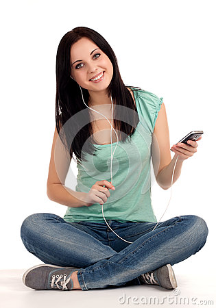Teenage girl sitting and listening nusic