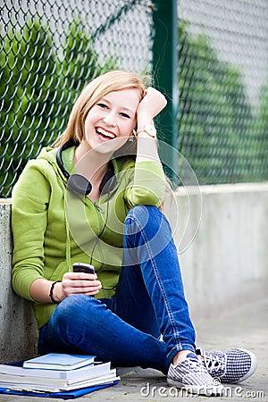 Teenage girl sitting outdoors