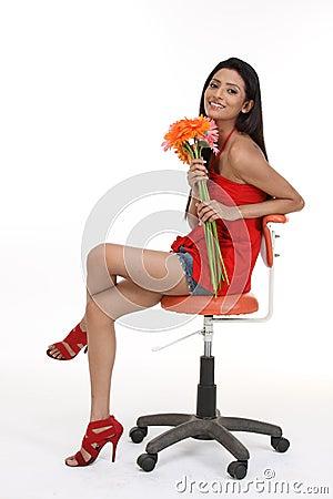 Teenage girl sitting on revolving chair