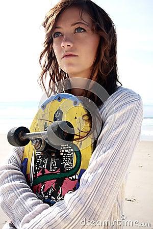 Teenage girl with skate board