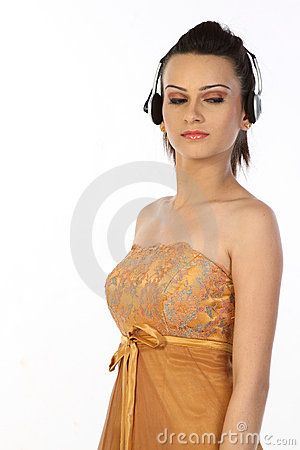 Teenage girl standing with headphones