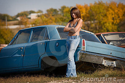 teenage girl standing next to car