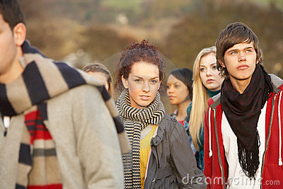 Teenage Girl Surrounded By Friends