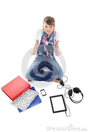 Teenage girl with tablet pc, phone and headphones