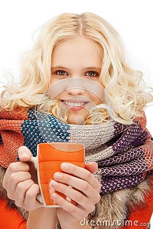 Teenage girl with tea or coffee mug
