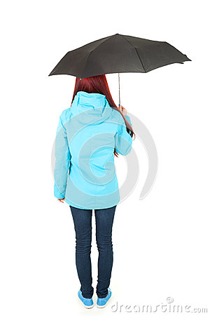 Teenage girl with umbrella, full length