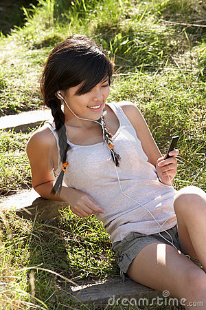 Teenage girl using mp3 player