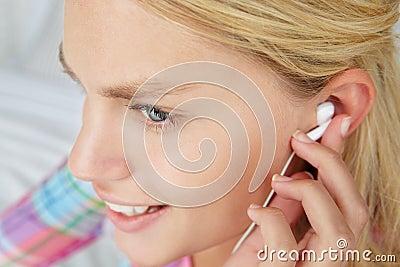 Teenage girl wearing earphones
