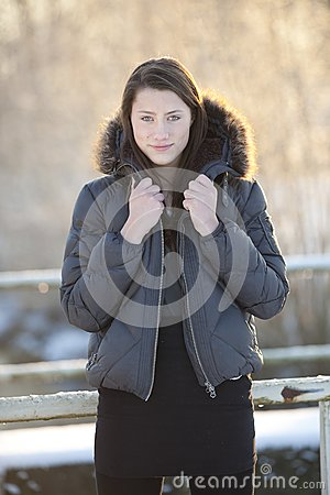 Teenage girl in winter woods