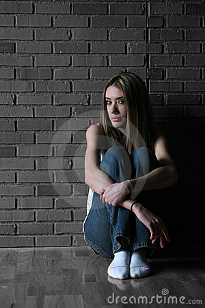 Free Teenage Girl With Her Knees Up Stock Photography - 5513012