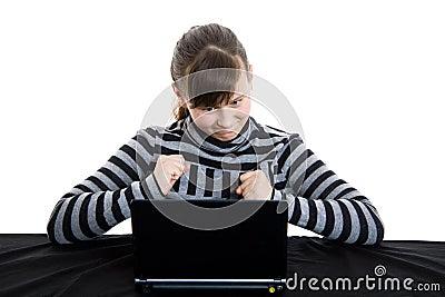 Teenage girl working with laptop