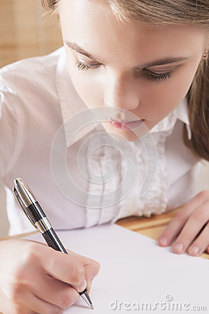 Teenage Girl Writing a Letter Stock Photo