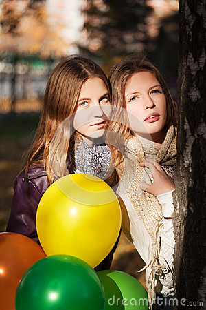 Young girls in autumn park