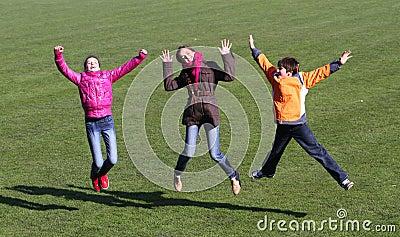 Teenage girls and boy enjoy to jumping
