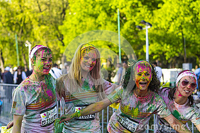 Teenage girls with colored powder smiling Editorial Photo