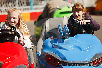 Teenage girls driving a bumper cars